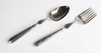 A matched George III silver serving fork and spoon, each with lion crest engraved to weighted