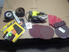 "LOT - RYOBI BELT SANDER, SAND PAPER ROLLS, BELTS, SHEETS, 10"" DISCS"