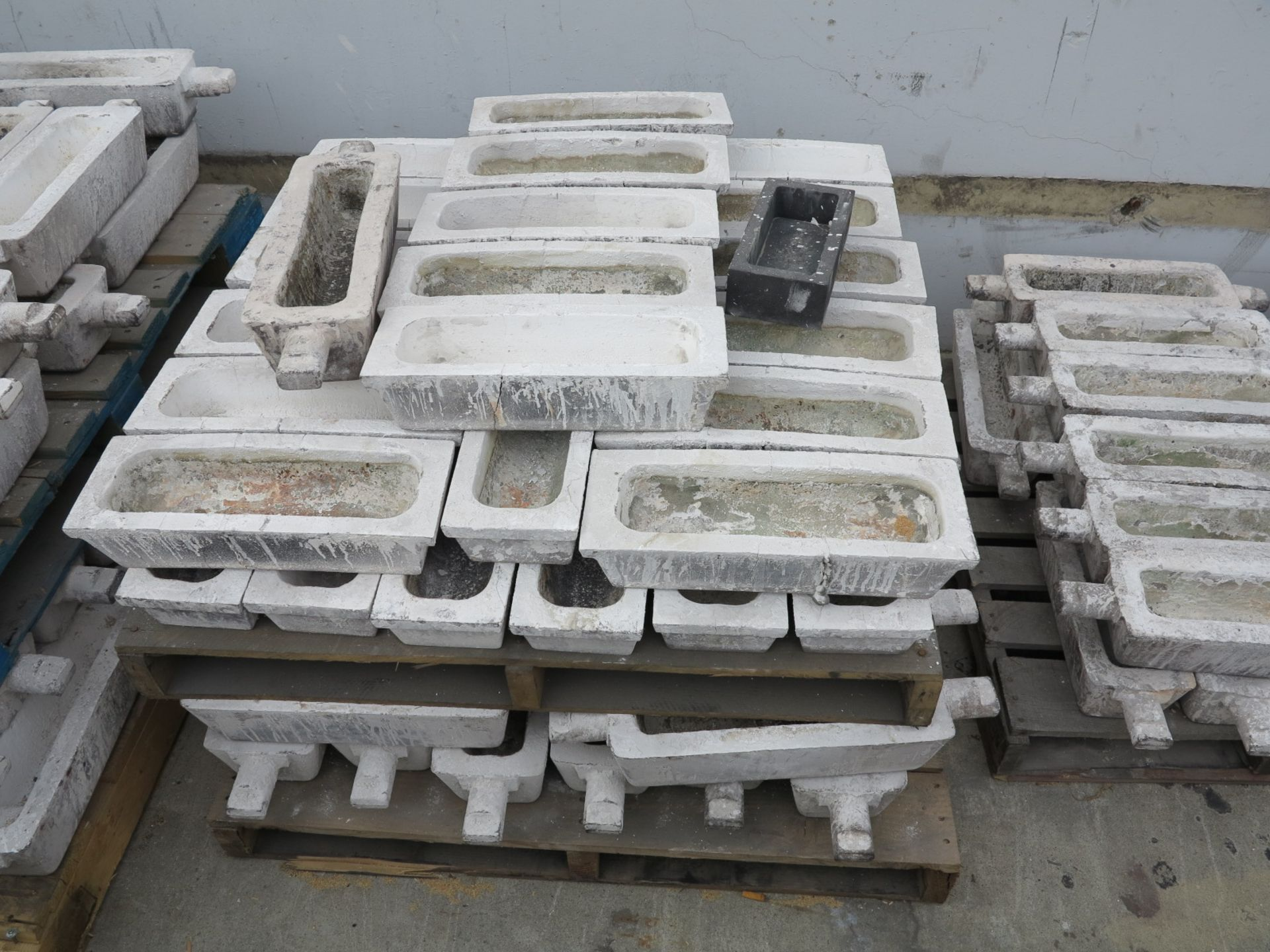 Lot 1204 - LOT - (4) PALLETS OF INGOT MOLDS AND (1) MOLD RACK