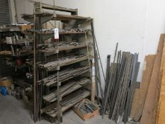 LOT - CONTENTS ONLY OF RACK: USEABLE BAR AND ROUND STOCK AND METAL ON RIGHT SIDE ON WALL