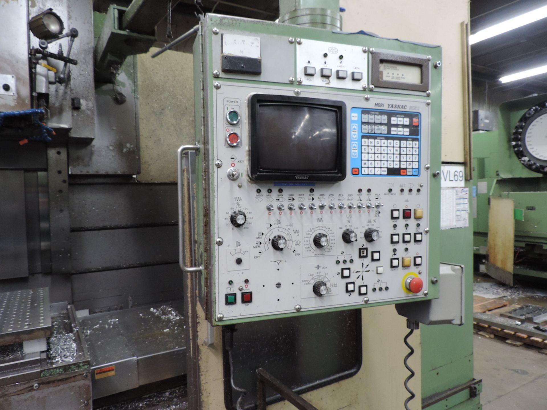 "MORI SEIKI MV-80 VMC, YASNAC MX-1 CONTROL, XYZ TRAVELS: 60"" X 31"" X 29"", 74"" X 32"" TABLE, 50 SPINDLE"