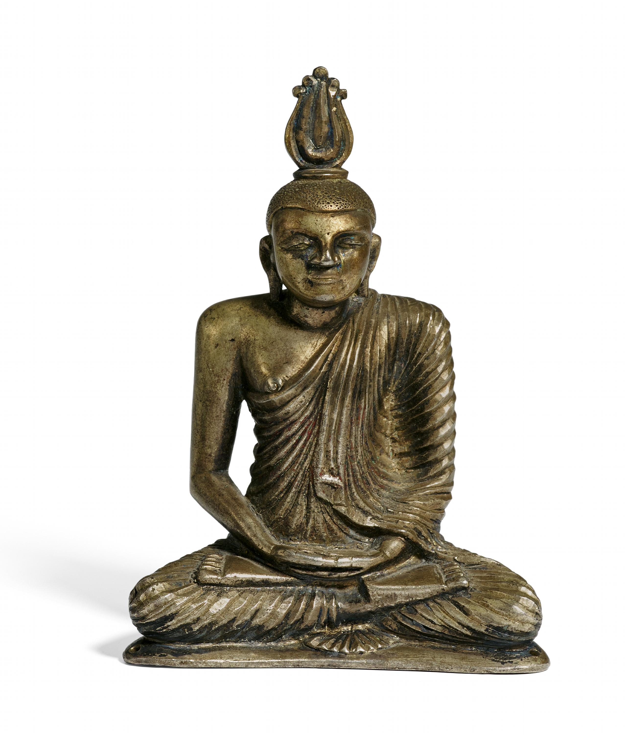 Lot 59 - BUDDHA SAMADHI. Origin: Sri Lanka/Ceylon. Date: 19th c. Technique: Silver. Thick-walled cast with