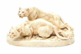Royal Dux, BohemiaA moulded ceramic group of two lionesses, designed by Otto Jarl (1856-1915),