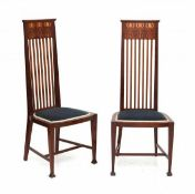 Arts & CraftsTwo mahogany high-back side chairs, the top of the backrest inlaid with repeating