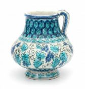 De Porceleyne Fles, DelftA Persian-inspired decorated ceramic vase with handle, circa 1910-1930,