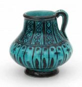 De Porceleyne Fles, DelftA Persian-inspired decorated ceramic vase with handle, green glazed,
