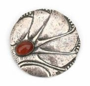 Cris Agterberg (1883-1948)A hammered silver brooch inset with cabochon cut carneole, circa 1930,