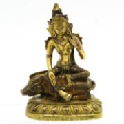 A Bronze Buddha Sculpture  Depicting Buddha seated on boar, 16 cm. tall. | Veilinghuis de Jager