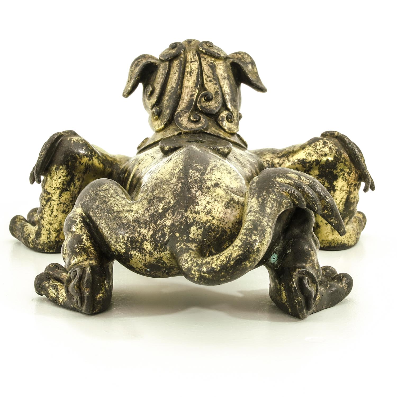 Lot 7060 - A Gilt Bronze Temple Lion