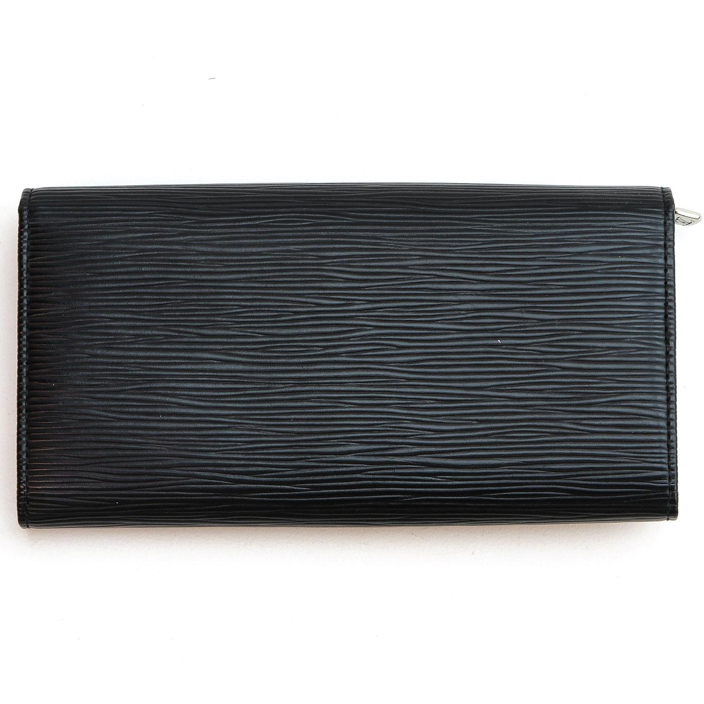 Lot 1267 - A Louis Vuitton Epi Leather Wallet