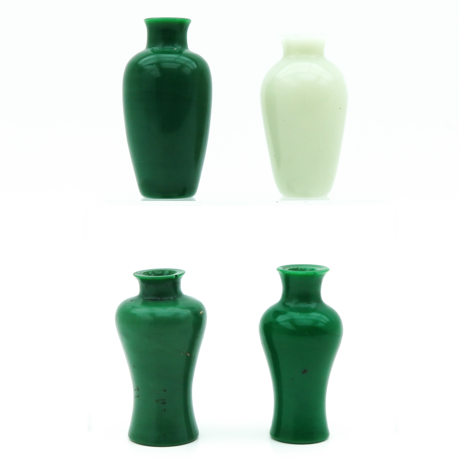 Lot 7044 - A Collection of 4 Jade Vases