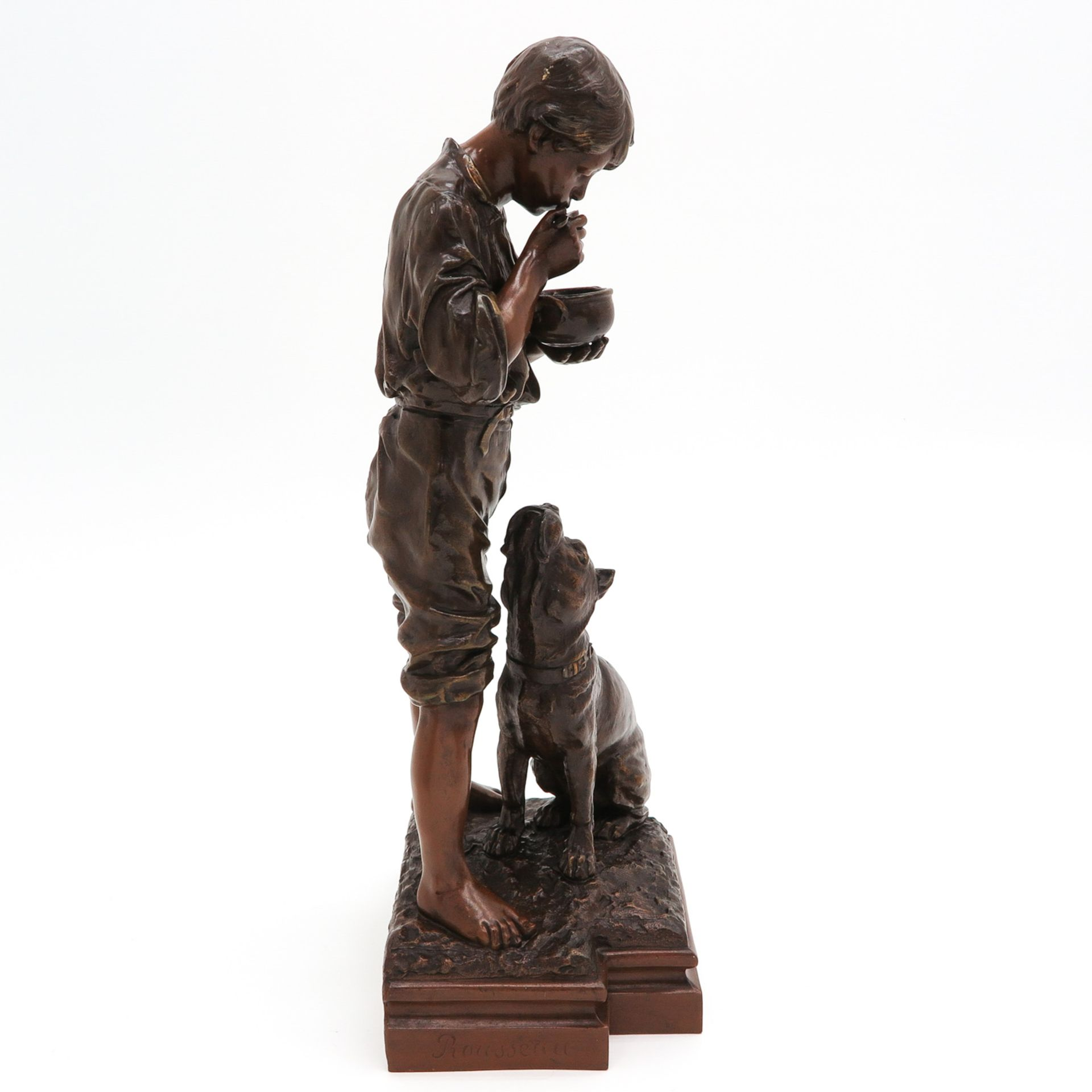 Los 1056 - A Sculpture of Boy with Dog