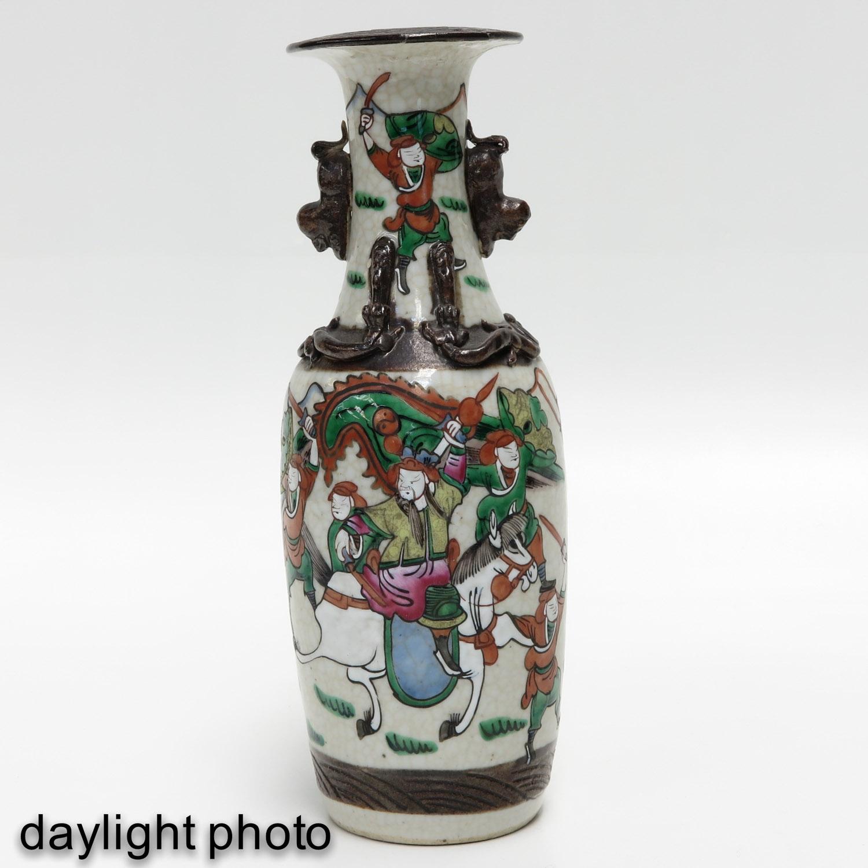 Lot 7015 - A Set of Three Nanking Vases