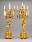 A pair of Louis XVI style nine light candelabra Gilt and relief bronze