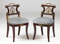 A pair of Empire style chairsMahoganyYellow metal applied elementsTextile upholstered s