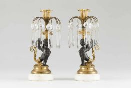 A pair of Regency candle standsGilt and patinated bronzePart engraved decoration of foliage