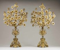 A pair of palms/twelve branch candelabraGilt bronzeUrns on neoclassical plinth shafts and f