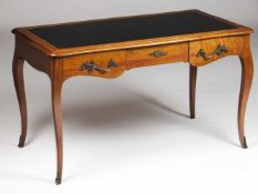 A Louis XV style writing deskWalnutLeather topThree drawers and yellow metal hardware<b