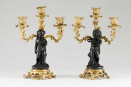 A pair of Louis XV style candelabraRaised, gilt and patinated bronzeFoliage motifs and putt