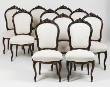 A set of ten Louis XV style chairsRosewood, foliage carved crestsYellow metal casters to fe