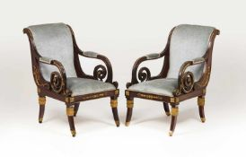 A pair of Empire style armchairsMahoganyApplied yellow metal elementsTextile upholstere