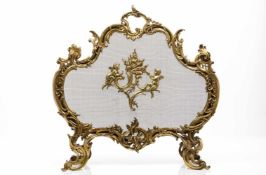 A louis XV style fireplace, Charles CasierGilt bronzeCentral putti decorationMarked <br