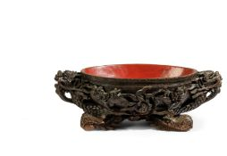 A VERY LARGE OVAL WOOD AND RED-LACQUERED DRAGON BOWL, CHINA, QING DYNASTY, REPUBLIC PERIOD