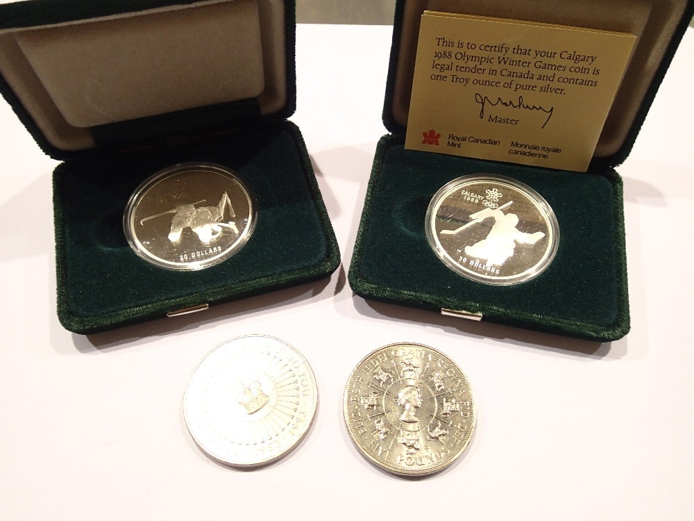 Lot 1259A - Two cased Canadian silver Olympic winter games £20 coins and two UK £5 coins