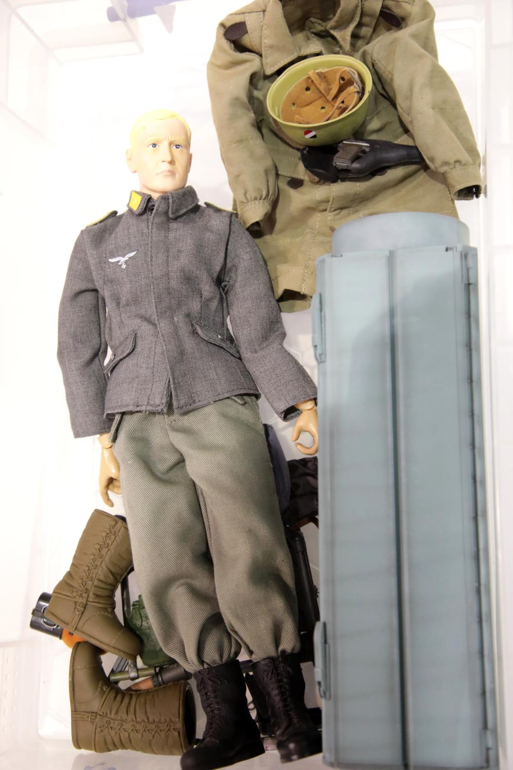 Lot 677 - Dragon WWII German soldier 1/6 scale action figure and accessories to include equipment parachute