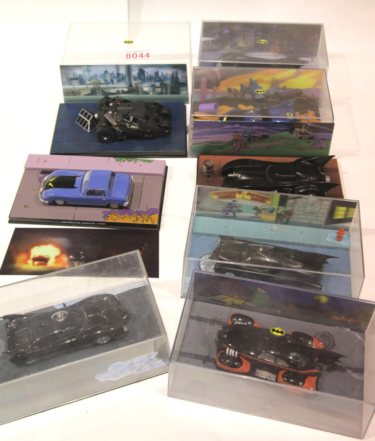 Lot 654 - Eight Detective comics Batmobile models in original boxes. P&P Group 2 (£18+VAT for the first lot