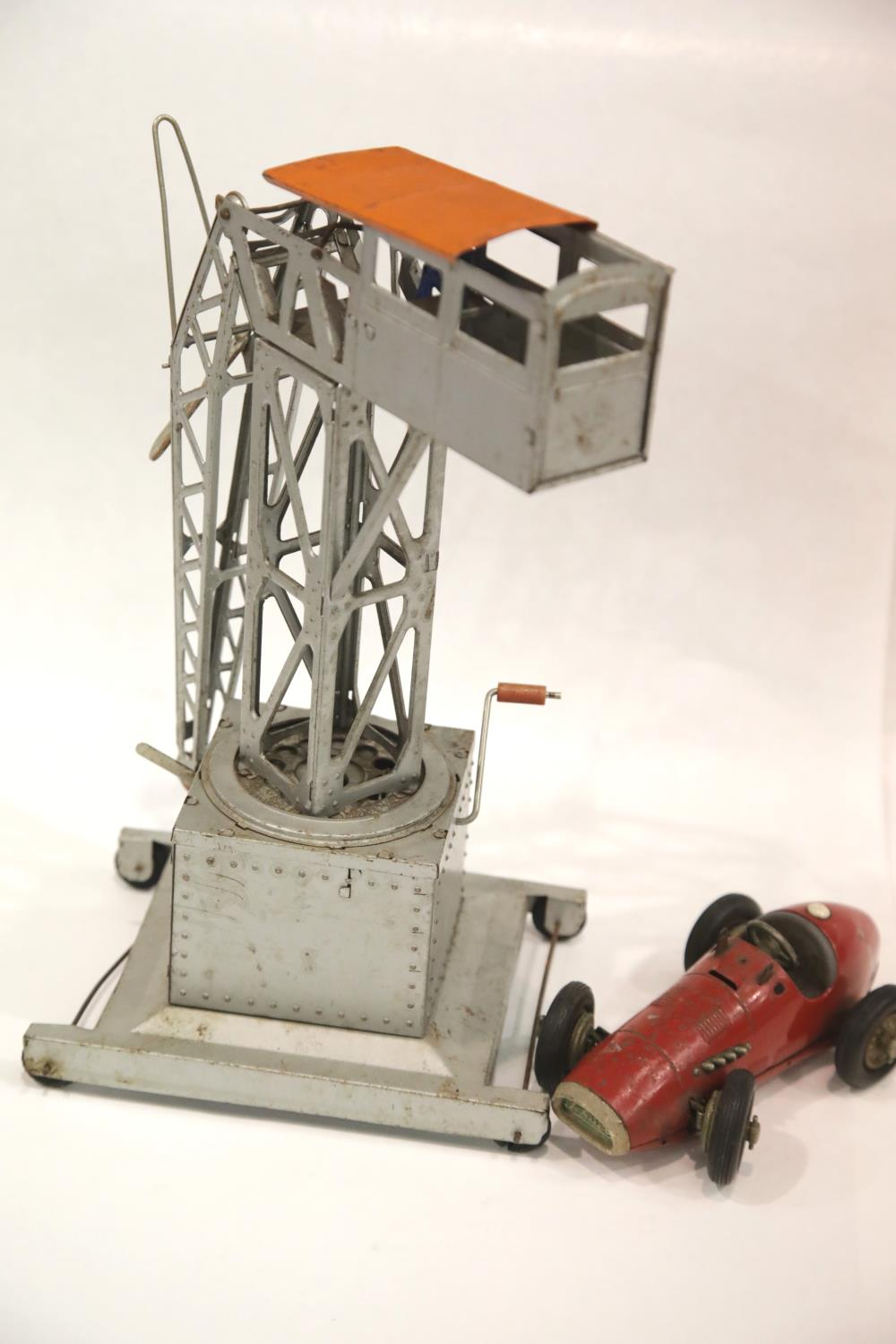 Lot 668 - Schuco Clockwork PMX racing car and a large tinplate toy crane. P&P Group 1 (£14+VAT for the first