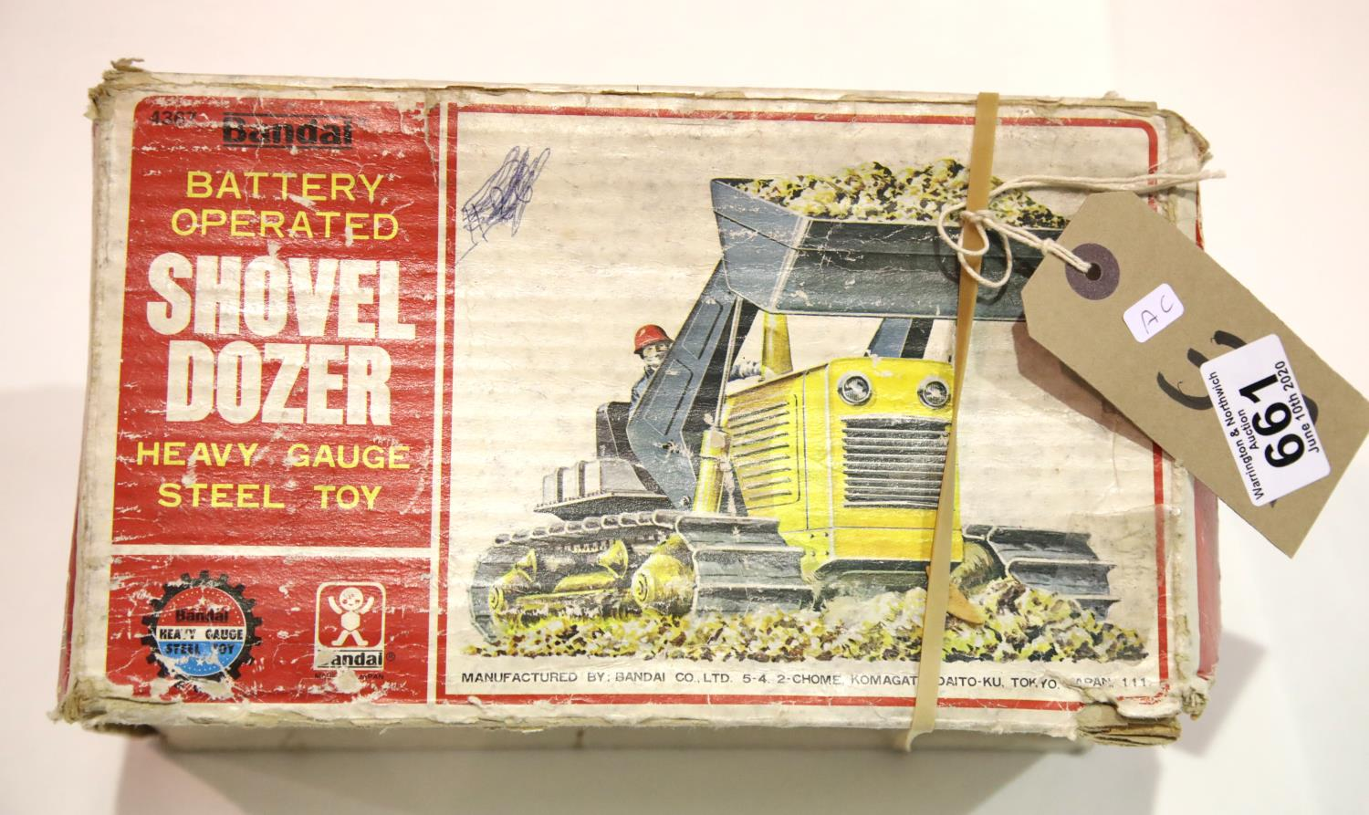 Lot 661 - Bandai battery operated shovel dozer steel toy. P&P Group 2 (£18+VAT for the first lot and £2+VAT