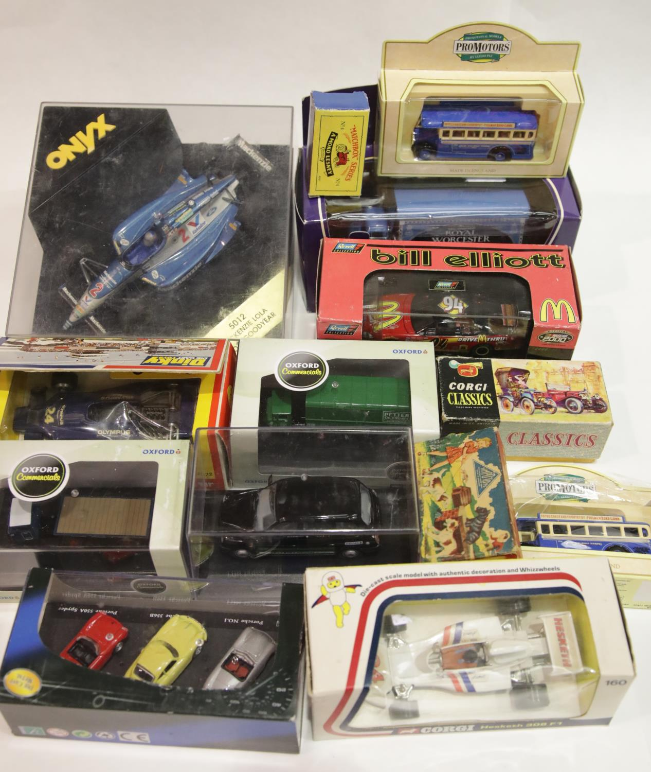 Lot 665 - Twelve boxed diecast vehicles including racing cars and buses: Corgi, Dinky, Matchbox etc P&P