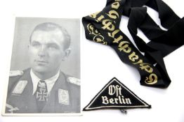 German Third Reich type photographic postcard of Major Ihlefeld, together with a Kriegsmarine hat