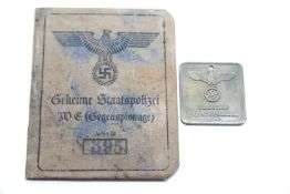 German SS type Gestapo brass tag and canvas covered identity book. P&P Group 1 (£14+VAT for the