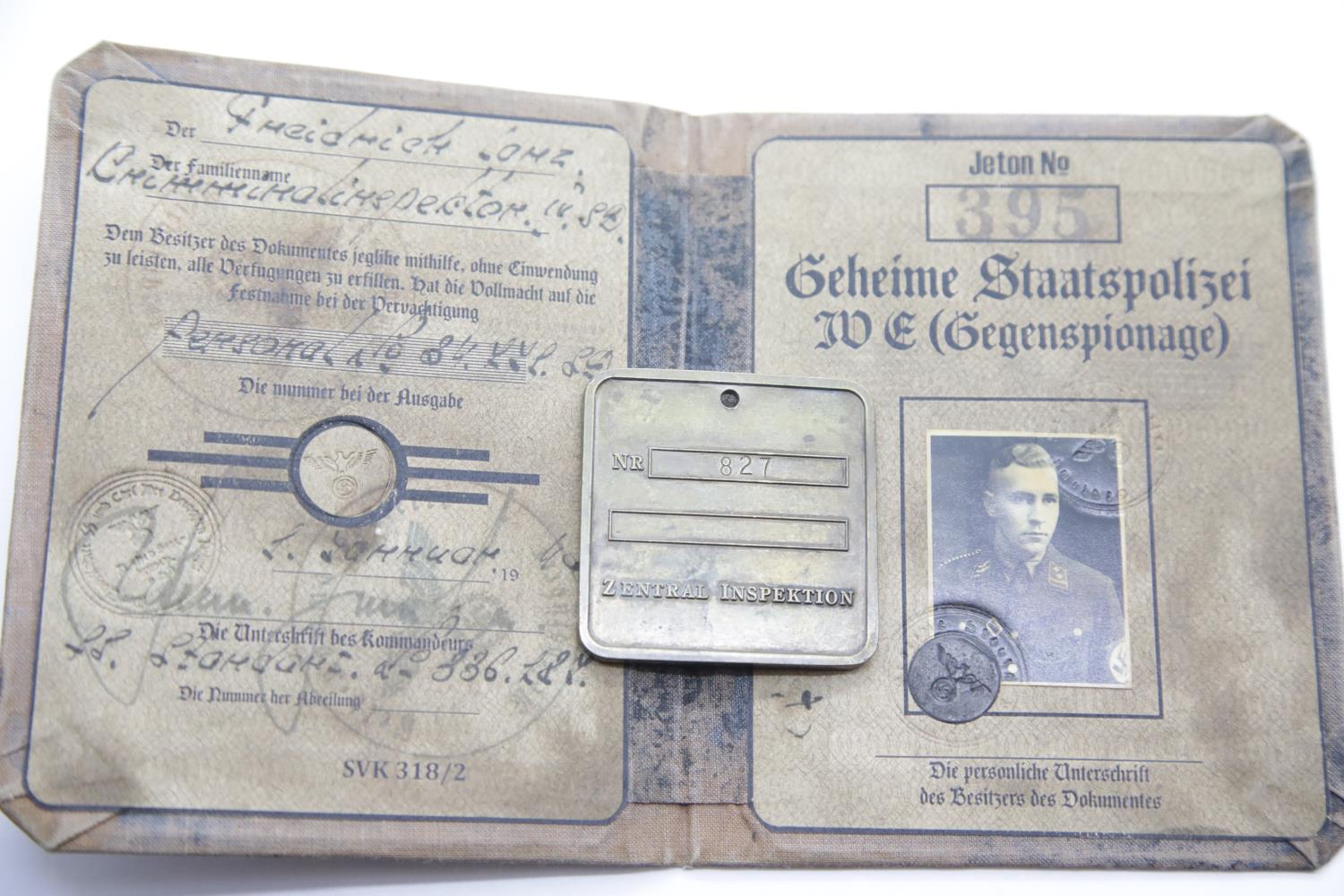 Lot 3044 - German SS type Gestapo brass tag and canvas covered identity book. P&P Group 1 (£14+VAT for the