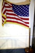 20th century American flag having 50 stars, gold fringed and raised on a brass mounted flagpole