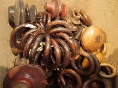 Box of antique wooden curtain rings and finials. Not available for in-house P&P