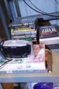 Selection of various DVDs and a digital clock radio. Not available for in-house P&P. Condition