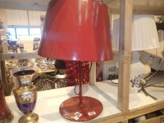Modern red metal table lamp with metal shade. Not available for in-house P&P. Condition Report: