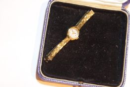 Ladies cocktail watch by Excalibur on gold tone strap. P&P Group 1 (£14+VAT for the first lot and £