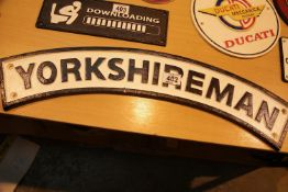 Cast iron Yorkshireman sign, L: 60 cm. P&P Group 2 (£18+VAT for the first lot and £3+VAT for