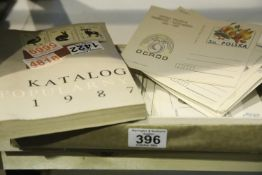 Quantity of Polish prepaid postcards and a catalogue. Not available for in-house P&P