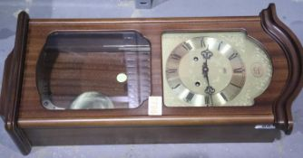 Modern mahogany effect cased wall clock. Not available for in-house P&P