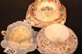 Decorative Foley china cup and saucer and a Grosvenor china (Van Dyke) pattern trio and a decorative