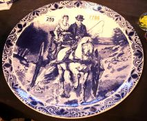 Hand painted Delftware ceramic charger plate depicting a gent and lady on horse drawn carriage.