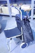 Shopping trolley with integral fold out seat, shopping bag is fully removable and rubber tipped