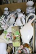 Box of mixed ceramics including Oriental, Egyptian and dog figurines. Not available for in-house P&P