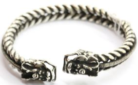 White metal Tibetan silver twisted bangle with dragon head finials. P&P Group 1 (£14+VAT for the