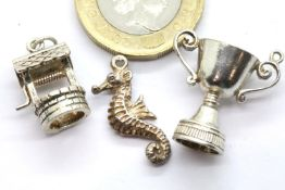Three 1970s silver charms. P&P Group 1 (£14+VAT for the first lot and £1+VAT for subsequent lots)